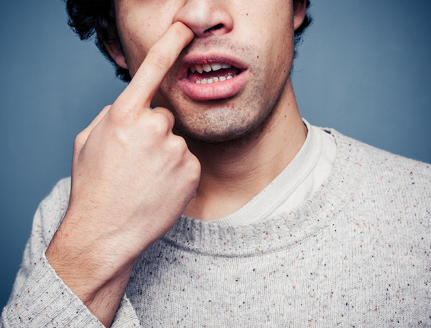 Horrible habits: Image of man picking his nose