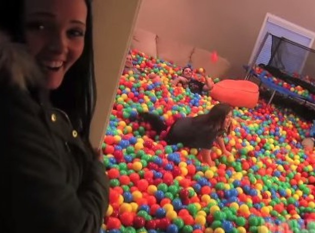 A woman finding her living room has been turned into a giant ballpit