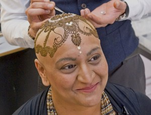 Ash Kumar  artist HK makes a henna crown for dipika patel diagnosed with stage 2 breast cancer in may of this year pictured at AK studio acton west londonfor raising awareness about breast cancer breast cancer awareness month october 2014.