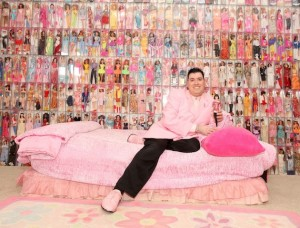Stanley Colorite, 41, poses for a picture in his bedroom where his largest part of his Barbie collection is displayed.