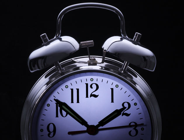 image of clock set at 10 to 2 in the morning
