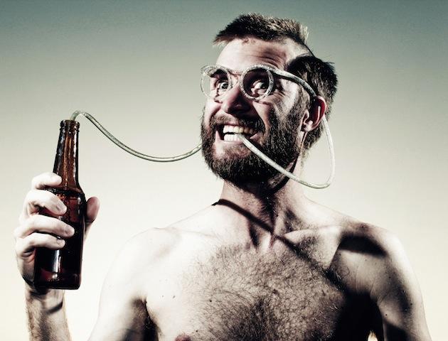 Funny man drinking beer