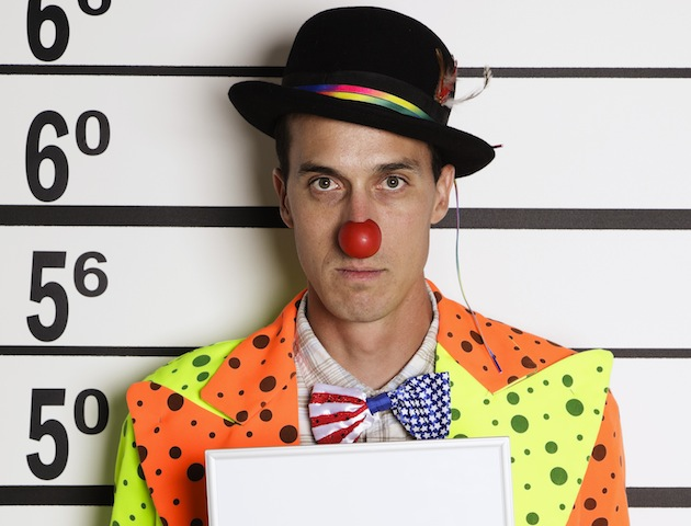 red nosed bowler hatted clown in police mug shot