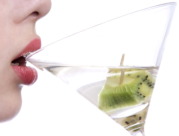 image of woman drinking from a cocktail glass