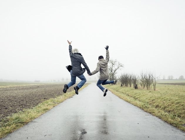 image of couple jumping in the air