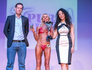 *** EXCLUSIVE - VIDEO AVAILABLE ***  KENT, UNITED KINGDOM - NOVEMBER 22: Alana collecting her trophy at the Pure Elite World Championships at Winter Gardens, on November 22, 2015 in Kent, England.  A disabled mother of two believes her dead son was watching over her as she won a prestigious bodybuilding competition. Alana Clark, 51, from Bristol, was born with cerebral palsy and has always had health problems. After a severe stroke at 36 she was left in a wheelchair and unable to speak. Luckily she recovered her ability to walk and talk but she still needs a cane to get around. Despite her physical disadvantages Alana has taken the bodybuilding world by storm after dedicating her training to her late son. Tom, 19, died four years ago in a car crash and Alana threw herself into exercise to help her overcome her grief. He is never far from Alana?s mind and she believes he was there as she was crowned the winner in a world championship bodybuilding competition.  PHOTOGRAPH BY Nick Cunard / Barcroft Media   UK Office, London. T +44 845 370 2233 W www.barcroftmedia.com  USA Office, New York City. T +1 212 796 2458 W www.barcroftusa.com  Indian Office, Delhi. T +91 11 4053 2429 W www.barcroftindia.com