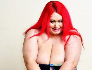 *** EXCLUSIVE ***  DERBYSHIRE, UNITED KINGDOM - UNDATED: A file photo of Claire Smedley at home in West Hallam in Derbyshire, England.  BUSTY Claire Smedley is blessed with the biggest breasts in Britain - but she is terrified they'll kill her relationship. The 30-year-old mum of three, from Derby, nearly killed her ex boyfriend when she smothered him with her 40 LL bust. Now her boobs weigh a staggering 2.5 stone each after growing to 40MMM - and she's worried she could injure new boyfriend Chris Willgoose, 30.  PHOTOGRAPH BY John Robertson / Barcroft Media  UK Office, London. T +44 845 370 2233 W www.barcroftmedia.com  USA Office, New York City. T +1 212 796 2458 W www.barcroftusa.com  Indian Office, Delhi. T +91 11 4053 2429 W www.barcroftindia.com  PHOTOGRAPH BY John Robertson / Barcroft Media  UK Office, London. T +44 845 370 2233 W www.barcroftmedia.com  USA Office, New York City. T +1 212 796 2458 W www.barcroftusa.com  Indian Office, Delhi. T +91 11 4053 2429 W www.barcroftindia.com