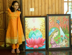 Swapna with some of her paintings produced using her feet