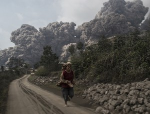 INDONESIA, 2010-2016: The volcano had lain dormant for four centuries until 2010 when it began showing signs of life again, North Sumatra province, Indonesia, 2010-2016.  THESE shocking images shows the harsh reality of life in the shadow of an erupting volcano. An estimated 30,000 people were displaced from their homes after Mount Sinabung on the Indonesian island of Sumatra started erupting on June 2, 2010 - after 400 years of laying dormant. Officials have placed the 2,460-metre volcano under a high risk warning ever since, with eruptions continuing on a periodic basis.  PHOTOGRAPH BY Sutanta Aditya / Barcroft Media  UK Office, London. T +44 845 370 2233 W www.barcroftmedia.com  USA Office, New York City. T +1 212 796 2458 W www.barcroftusa.com  Indian Office, Delhi. T +91 11 4053 2429 W www.barcroftindia.com