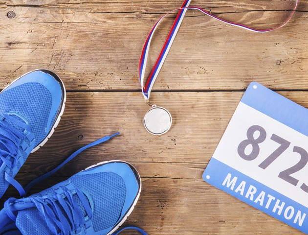 image of a pair of running shoes and marathon number