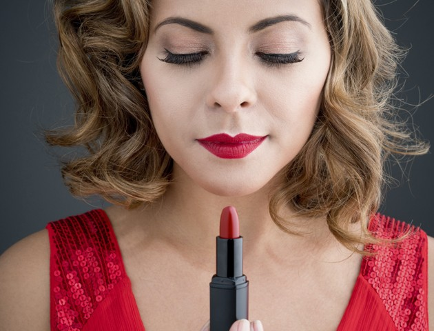 image of woman looking at a red lipstick