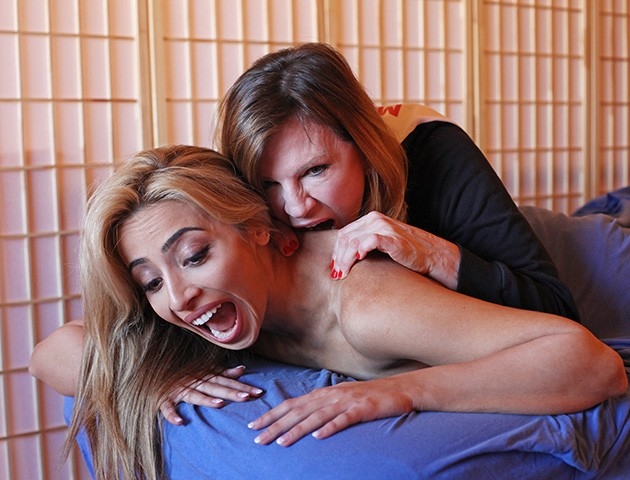 captives-girl-massaging-her-breasts
