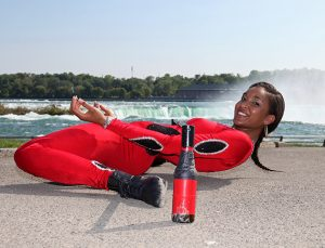 *** EXCLUSIVE - VIDEO AVAILABLE ***  BUFFALO, NY - MAY 28: Shemika Charles limbos under a stick on top of two regular 330ml beer bottles at Niagara Falls State Park on May 28, 2015 in Buffalo, New York.  A WORLD record holding limbo queen thinks she has become the first person to shimmy under a car. Shemika Charles amazed herself and onlookers when she bent over backwards to get underneath the SUV earlier this week. The supple 22-year-old entered the record books in 2010 when she limboed down to an incredible eight and a half inches ? the height of a beer bottle. She trains for up to four hours a day to keep her body in peak condition and now travels around America performing with her family. However, regular performances put an incredible strain on her body and she sees a chiropractor once a week to have her hips realigned. Her mother was also a successful limbo dancer in her home country of Trinidad and Tobago but had to give up due to injury.   PHOTOGRAPH BY Ruaridh Connellan / Barcroft USA  UK Office, London. T +44 845 370 2233 W www.barcroftmedia.com  USA Office, New York City. T +1 212 796 2458 W www.barcroftusa.com  Indian Office, Delhi. T +91 11 4053 2429 W www.barcroftindia.com