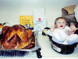 *** EXCLUSIVE - VIDEO AVAILABLE *** *** FILE PHOTO *** KITCHENER, ONTARIO - 2003: Kenadie Jourdin-Bromley next to a Thanksgiving turkey at one-year-old in Kitchener, Ontario.  AT TWELVE years old tiny Kenadie Jourdin-Bromley stands at just 39.5 inches tall and weighs the same as a two year old. The bubbly schoolgirl has defied doctors since the day she was born weighing just 2.5lbs and 11 inches from head to toe. Kenadie's mum, Brianne Jourdin, 36, was told her daughter wouldn?t survive more than a few days. However, despite having learning difficulties and fragile, thin bones - Kenadie plays hockey, swims, and functions in school.  PHOTOGRAPH BY Barcroft USA  UK Office, London. T +44 845 370 2233 W www.barcroftmedia.com  USA Office, New York City. T +1 212 796 2458 W www.barcroftusa.com  Indian Office, Delhi. T +91 11 4053 2429 W www.barcroftindia.com