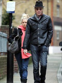 Sienna Miller and Rhys Ifans wander round town