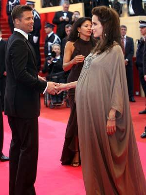 Angelina Jolie and Brad Pitt share a tender moment