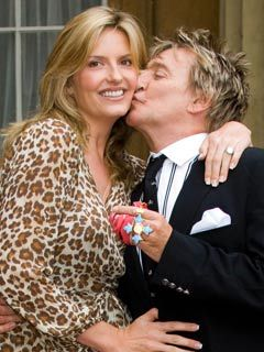 Penny Lancaster and Rod Stewart celebrate as he receives his CBE