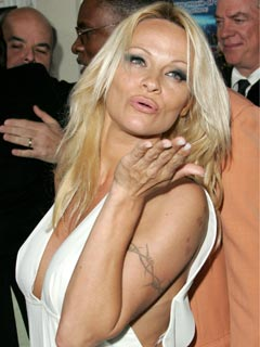 Pamela Anderson blows a kiss