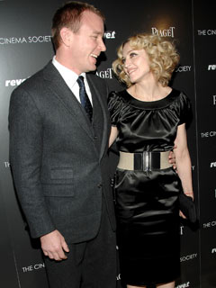 Guy Ritchie and Madonna look loved up
