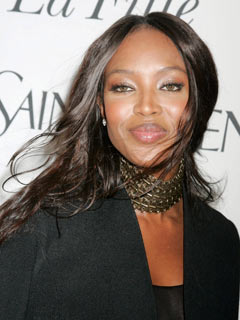 Naomi Campbell looks demure at the opera