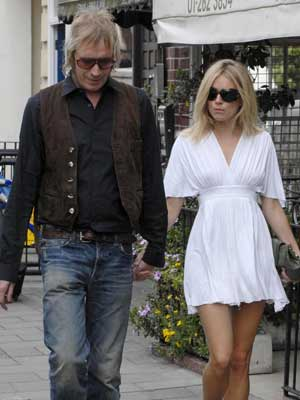 Sienna Miller and Rhys Ifans do not match in the looks department
