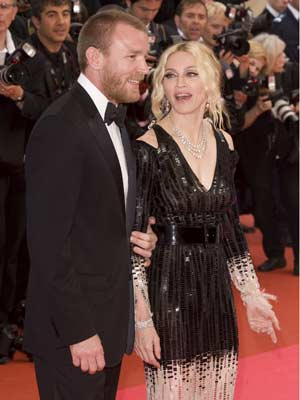 Guy Ritchie keeps a firm grip on Madonna