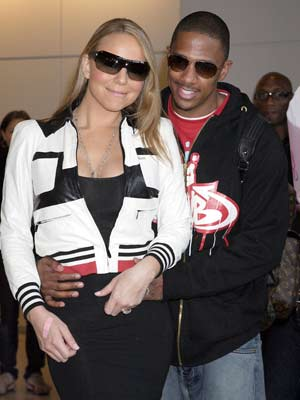 Newlyweds Mariah Carey and Nick Cannon cosy up