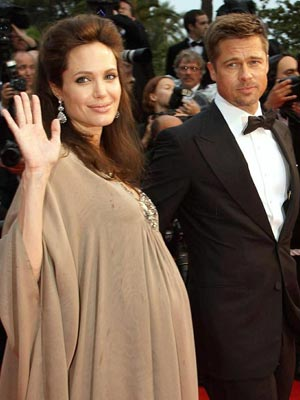 Angelina Jolie and Brad Pitt await the arrival of their twins