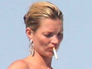 Kate Moss puffs away during her hols