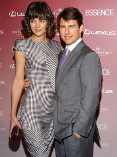 Katie Holmes stands tall next to Tom Cruise