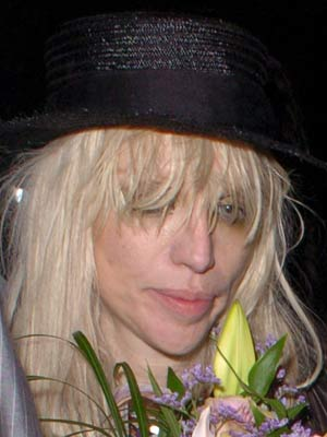 Stars without make-up: Courtney Love tries to hide her face