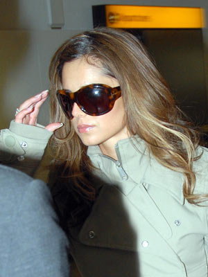 Cheryl Cole wears sunglasses to hide her face - February 2008