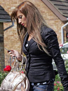 Chantelle Houghton looks down in the dumps