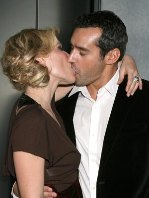 Husband and Wife Couple; Natasha and Matthew kissing each other