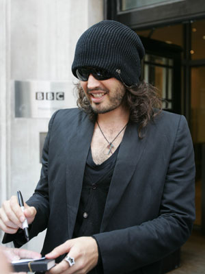 Russell Brand covers up