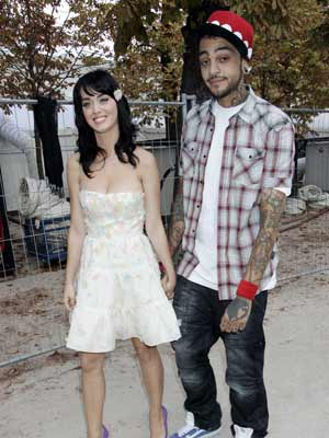 Katy Perry drags along her man