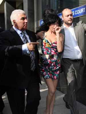 Amy Winehouse and dad Mitch Winehouse | Amy Winehouse and dad Mitch Winehouse at Westminster Magistrates ' Court | Now Magazine