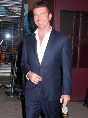 Simon Cowell | Simon Cowell keeps his drink close to hand | Pictures | Now magazine | celebrity gossip