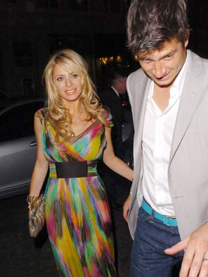 Vernon Kay protects his wife Tess Daly