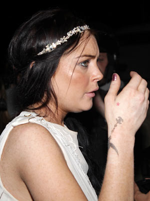 Lindsay Lohan and her new wrist tattoo | Lindsay Lohan at the Cannes Film Festival | Now Magazine | Celebrity Gossip | Pictures