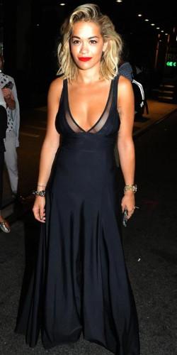 236e1c0a3d086 Rita Ora strips! Singer risks nipple slip as she whips off bra while ...