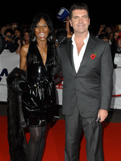Sinitta and Simon Cowell pose on the red carpet
