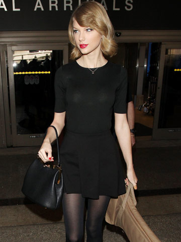 Taylor Swift works sexy retro look with hot red lips and