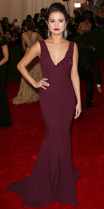 Selena Gomez swaps dungarees for sexy purple dress to dance with ...