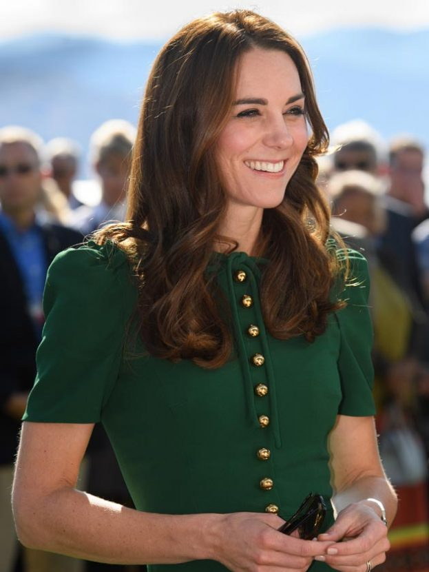 The Duchess of Cambridge speaks with local schoolchildren at a food and wine festival in British Columbia on Tuesday wearing a gorgeous green Dolce and Gabbana dress.