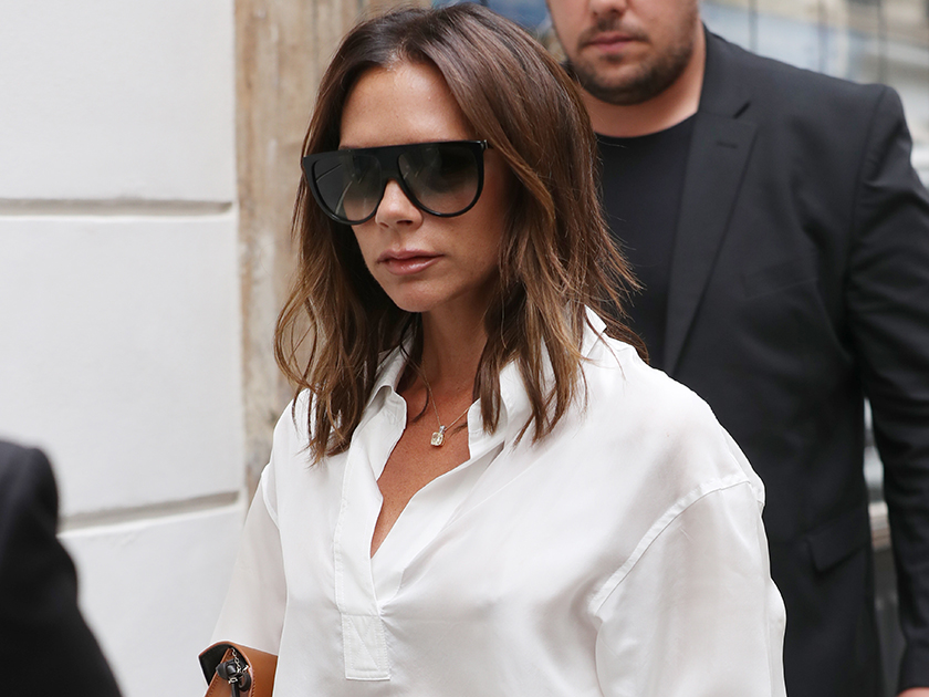 Victoria Beckham, is that you? Posh Spice looks UNRECOGNISABLE in slashed leather top for cringey solo music video