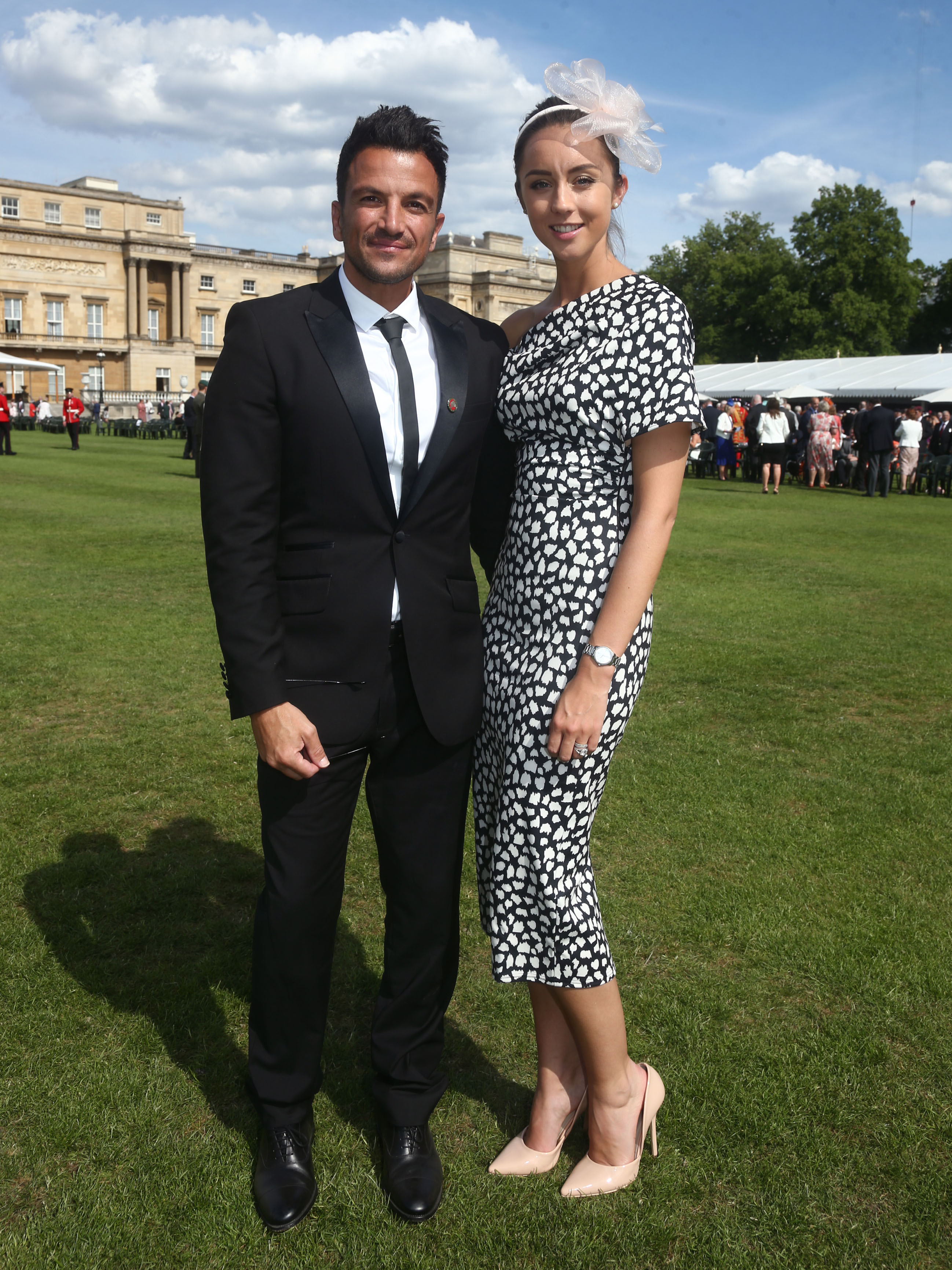 Peter Andre's wife Emily STUNS in £38 dress at Buckingham Palace reception