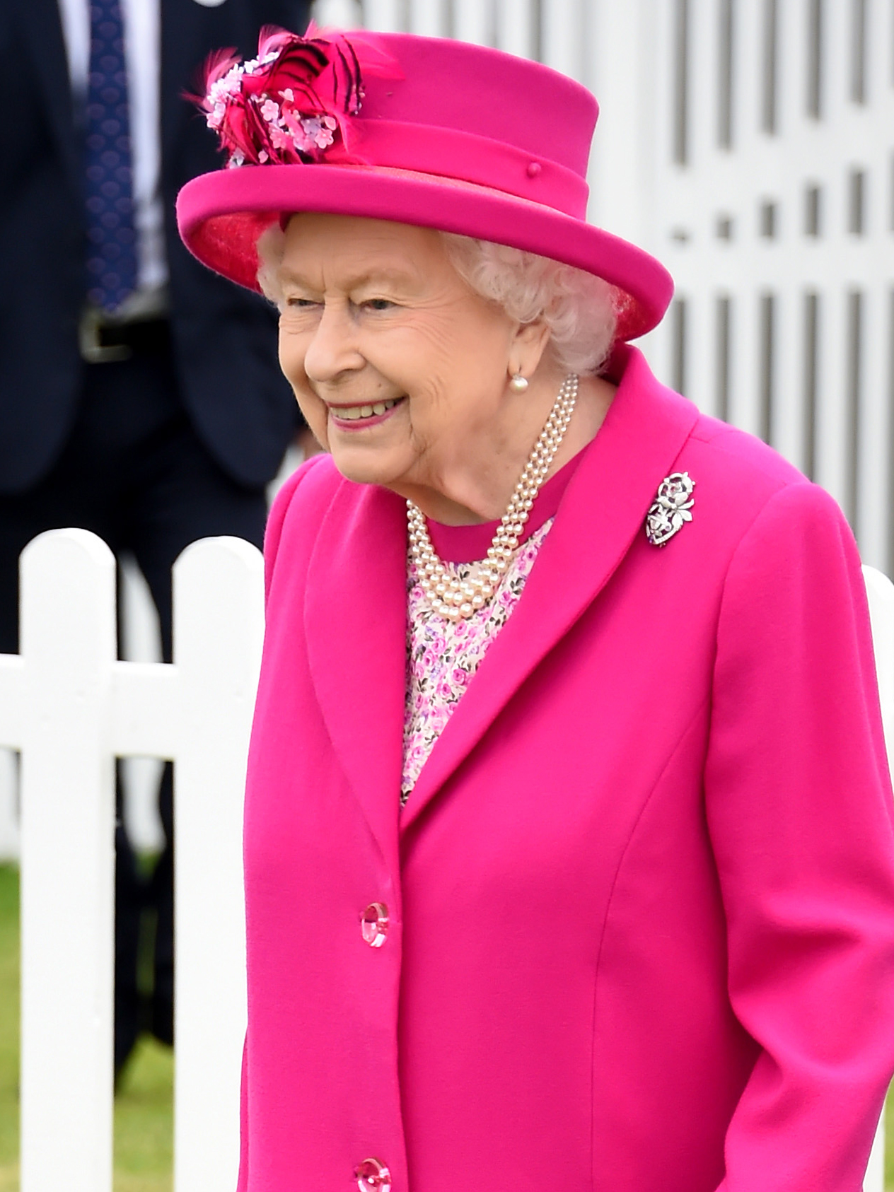 The Queen is completely unfazed after guest's scarf blows in her face at the polo