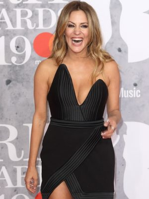f87da11fd Caroline Flack teased over relationship with Harry Styles as she bares  thighs in unbelievably revealing snap