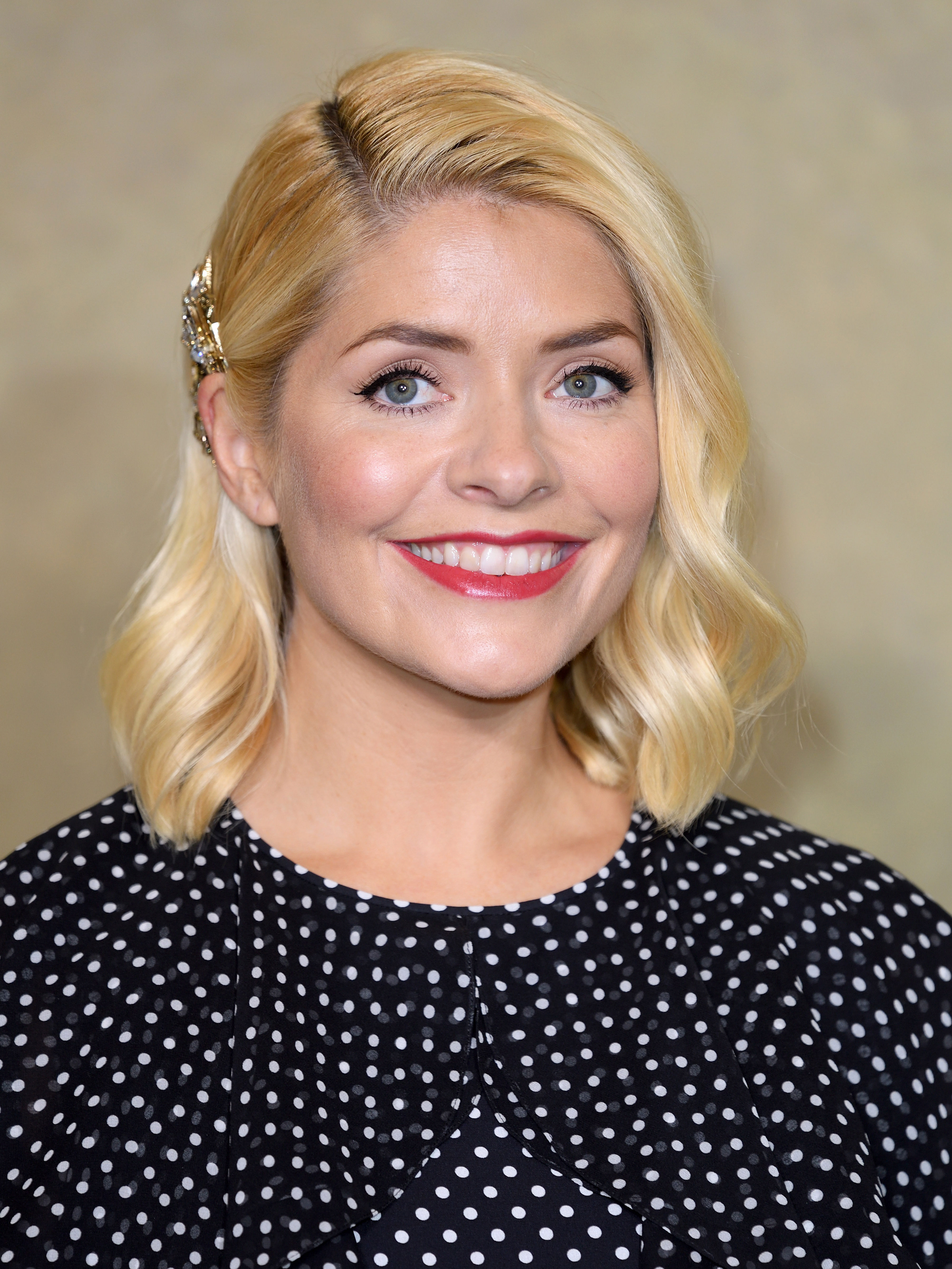 Holly Willoughby looks gorgeous in figure-hugging white swimsuit as she shares hilarious rare snap of prankster son Harry
